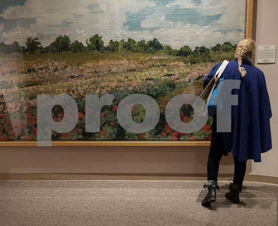 """Sandra Dougherty, promotions and brand ambassador for Kiepersol, looks at a piece of artwork inside the Tyler Rose Museum during the """"Keepin' Tyler Rosy"""" Destination Training held by the Tyler Chamber of Commerce on Thursday Dec. 7, 2017. The program is a training event designed to educate front line staff from local businesses on what Tyler has to offer to their clients and visitors as well as customer service training.  (Sarah A. Miller/Tyler Morning Telegraph)"""
