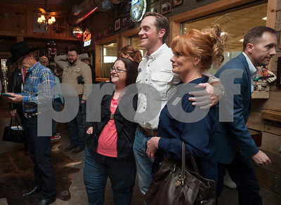 Jennifer Audet of Gladewater, left, and Stacy McMahon of Gilmer, right, take a photograph with United States Congressional candidate Jason Wright during the Grassroots America – We the People's Northeast Texas Conservative Superstars 2018 Primary Election Kick-off held on Saturday Jan. 27, 2018 at Rio Neches Cattle Company in Tyler, Texas.   (Sarah A. Miller/Tyler Morning Telegraph)