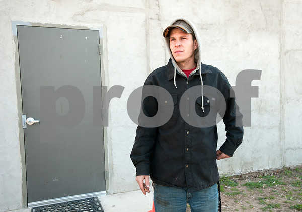 "photo by Sarah A. Miller/Tyler Morning Telegraph  Shane Trull, 26, stands outside Gateway to Hope Day Resource Center Tuesday morning after he and other homeless men and women were told to leave their camping area on Union Pacific property Monday night. ""We're just trying to figure it all out. It's a weird situation,"" he said."