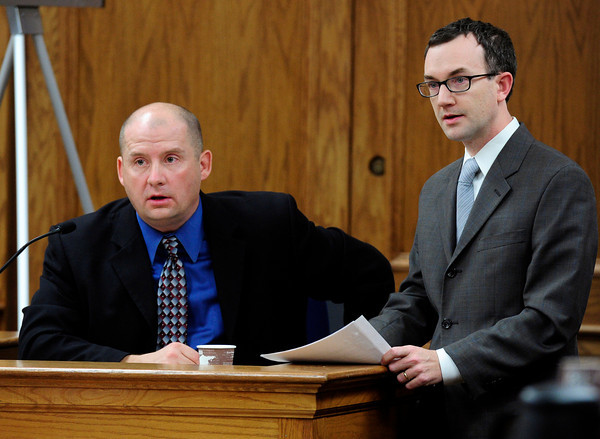 Boulder police Detective Kurt Foster, left and Kevin McGregor's attorney John Gifford, right, listen to the prosecution object regarding Kevin McGregor's interview transcript at the start of the afternoon session of his trial at the Boulder County Justice Center in Boulder, Colorado January 30, 2012. McGregor is charged with the murder of Todd Walker in March of 2011. Paul Aiken / The Camera