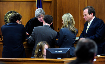 From left to right Public defenders Eric Zale and John Gifford,  Deputy District Attorney Karen Lorenz and District Attorney Stan Garnett work over the details of evidence in front of Boulder District Judge D.D. Mallard during Kevin McGregor's murder trial on Monday January 30 at the Boulder County Justice Center. Photo by Paul Aiken