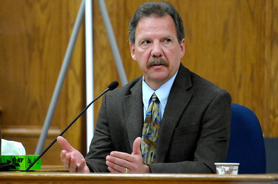 Detective Chuck Heidel returns to the witness stand during the third day of Kevin McGregor's trial at the Boulder County Justice Center in Boulder, Colorado January 30, 2012.  McGregor is charged with the murder of Todd Walker in March of 2011. CAMERA/MARK LEFFINGWELL