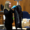 Boulder Detective Kristin Weisbach shows the jury a black hooded sweatshirt found in Kevin McGregor's residence at his trial at the Boulder County Justice Center in Boulder, Colorado January 30, 2012. McGregor is charged with the murder of Todd Walker in March of 2011. Paul Aiken / The Camera