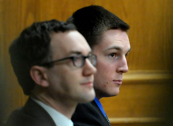 Sitting with one of his lawyers, John Gifford (left) Kevin McGregor (right) listens to the questioning of Jennifer Erin Kennedy, Which Wich manager, during the third day of his trial at the Boulder County Justice Center in Boulder, Colorado January 30, 2012.  McGregor is charged with the murder of Todd Walker in March of 2011. CAMERA/MARK LEFFINGWELL