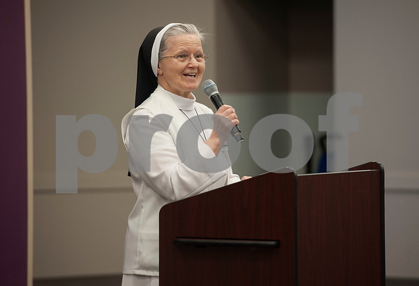 Sister Irene Asztemborska gives the invocation at the announcement that Christus Trinity Clinic, part of Christus Health, won the American Medical Group Association's 2017 Acclaim Award on Tuesday Jan. 30, 2018.   (Sarah A. Miller/Tyler Morning Telegraph)