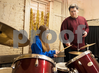 Rafael Espinoza teaches student Megan Holt, 13, during a music lesson on a drum set at the The Rafael Espinoza Music Academy in downtown Mineola Thursday Jan. 7, 2016.  (Sarah A. Miller/Tyler Morning Telegraph)