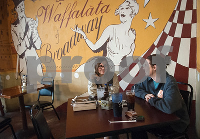 Taylor Conaway and Ashlyn Boulware, both of Tyler, eat lunch at La Waffalata in Mineola's historic downtown district Thursday Jan. 7, 2016. Mineola's downtown features a variety of unique stores selling everything from food and coffee to antiques, clothes, guns, art and home decor.   (Sarah A. Miller/Tyler Morning Telegraph)