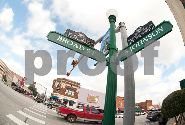 A street sign designates downtown Mineola as part a National Register Historic District Thursday Jan. 7, 2016. Mineola's downtown features a variety of unique stores selling everything from food and coffee to antiques, clothes, guns, art and home decor.   (Sarah A. Miller/Tyler Morning Telegraph)