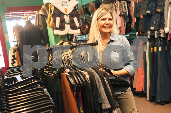 Owner Shiloh Alexander is pictured at her shop Haute Stuff Boutique in downtown Mineola Thursday Jan. 7, 2016. Haute Stuff Boutique is a women's clothing and jewelry store.  (Sarah A. Miller/Tyler Morning Telegraph)