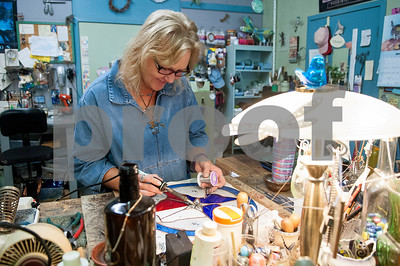 Melissa Brown, owner of Dragonfly Art Studio creates a stained glass decoration at her shop in Mineola's historic downtown district Thursday Jan. 7, 2016. Mineola's downtown features a variety of unique stores selling everything from food and coffee to antiques, clothes, guns, art and home decor.   (Sarah A. Miller/Tyler Morning Telegraph)