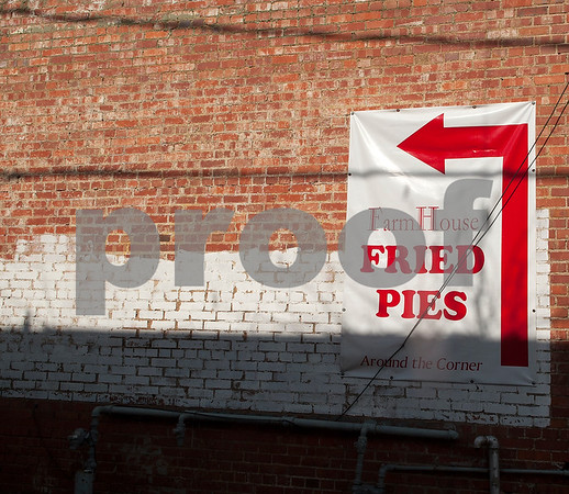 A sign points to a shop selling fried pies in downtown Mineola Thursday Jan. 7, 2016. Mineola's downtown features a variety of unique stores selling everything from food and coffee to antiques, clothes, guns, art and home decor.   (Sarah A. Miller/Tyler Morning Telegraph)