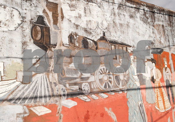 Art and signs depicting trains, such as this mural spanning the side of a building, is abundant in downtown Mineola Thursday Jan. 7, 2016. An Amtrak depot is located in downtown Mineola.  (Sarah A. Miller/Tyler Morning Telegraph)