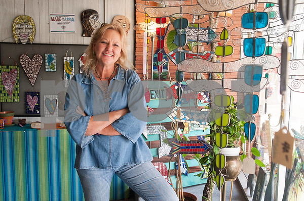 Melissa Brown, owner of Dragonfly Art Studio is pictured at her shop in Mineola's historic downtown district Thursday Jan. 7, 2016. Mineola's downtown features a variety of unique stores selling everything from food and coffee to antiques, clothes, guns, art and home decor.   (Sarah A. Miller/Tyler Morning Telegraph)