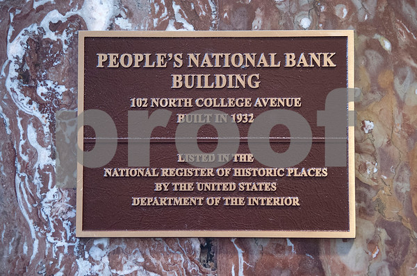 A sign posted on the historic red marble walls notes The People's Petroleum Building in downtown Tyler as listed in the National Register of Historic Places.  (Sarah A. Miller/Tyler Morning Telegraph)
