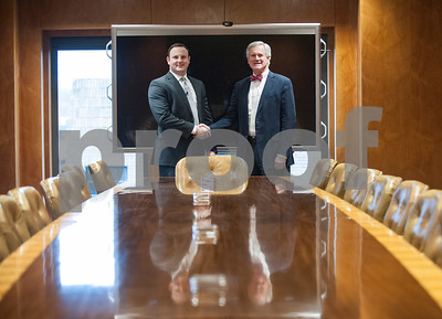Current owners and developers Garnett Brookshire and Tim Brookshire are pictured in the boardroom of The People's Petroleum Building in downtown Tyler. When the Brookshires and Andy Bergfeld purchased the commercial building is was only 7 percent occupied, and now it is over 70 percent occupied.   (Sarah A. Miller/Tyler Morning Telegraph)