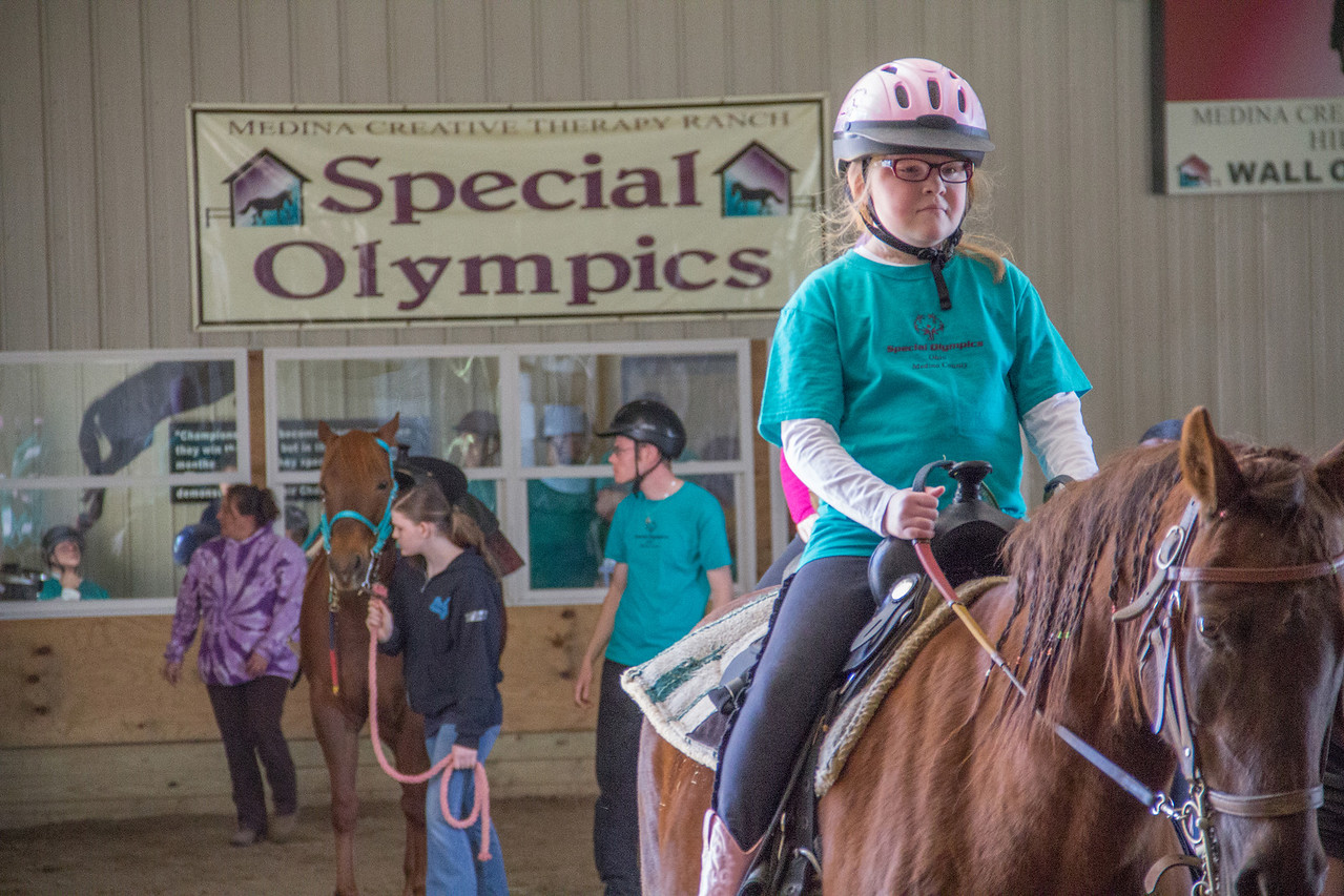 ALEC SMITH / GAZETTE Ashley Betz gets ready to compete Saturday at the Medina Creative Therapy Ranch's Special Olympics Horse Show. She was entered in the Class A Western Equitation's Walk / Trot and in the Class A Barrels' and Class B Barrels' Trot events.