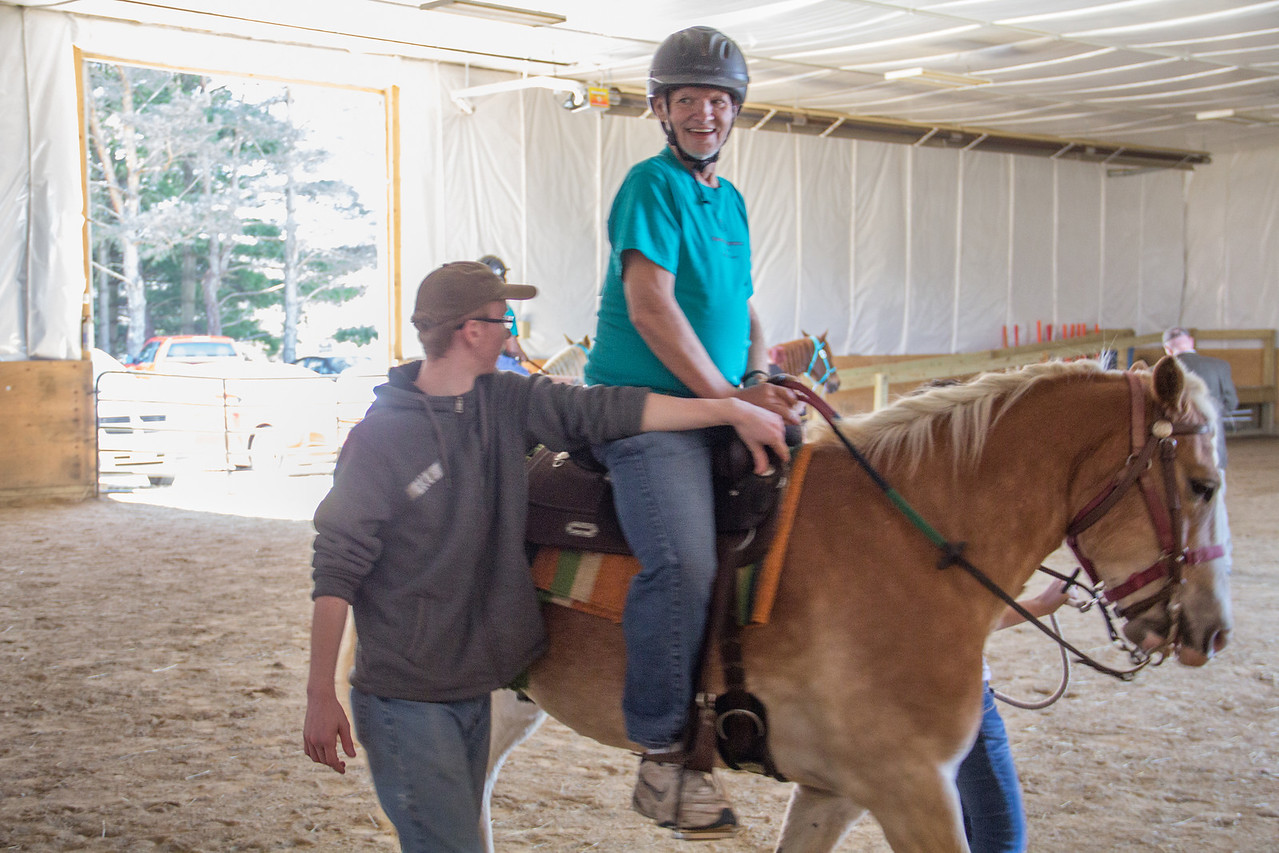 ALEC SMITH / GAZETTE Greg Schaeffer smiles at his family as he participates Saturday in Medina Creative Therapy Ranch's 2016 Special Olympics Horse Show at 5200 Lake Road, Medina. Schaeffer participated in Group 2 Walk in Class A Western Equitation and the Walk portion of the Class A Barrels event.