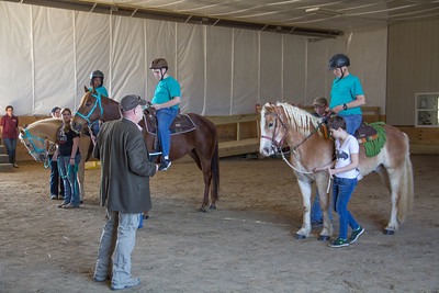 ALEC SMITH / GAZETTE From left to right, Micah Somogyi, Kenny Volk, and Greg Schaeffer are judged in the Group 2 Walk event called Class A Western Equitation. The three participated Saturday in the Medina Creative Therapy Ranch's Special Olympics Horse Show at 5200 Lake Road, Medina.