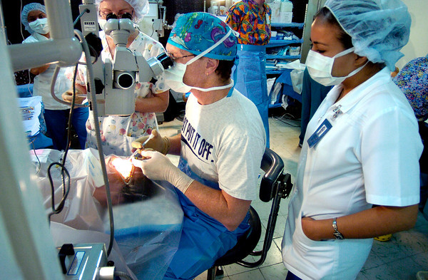 Dr. William Whalen  works to repair a cataract in a woman in the Mante Red Cross that has been converted into the eye clinic on Saturday, Feb. 5, 2005. The eye clinic repairs several hundred cataracts each year due to the extreme exposure to ultraviolet rays from the sun working and living in the tropical area, as the minimum wage is about $6 a day and sunglasses cost about $9.<br /> Photo by Joshua Lawton / Daily Camera / Feb 5, 2005