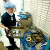 Tiffany Logan , center, and Michelle DelSanto begin to work on sterilizing hundreds of instruments used in surgeries at Hospital Civil only half-way through the day's docket of procedures on Feb. 6, 2005.<br /> Photo by Joshua Lawton / Daily Camera / Sunday, Feb 6, 2005