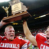 Globe/T. Rob Brown<br /> Webb City Cardinals teammates hold up the team's 2006 State Championship trophy at the Edward Jones Dome in St. Louis in November 2006.