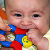 Globe/T. Rob Brown<br /> Bryson Strup, 4 months old, chews on a teething toy Monday afternoon, March 13, 2006, in his Galena, Kan., home with the aid of his mother Angie Strup.
