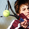 Globe/T. Rob Brown<br /> Joplin freshman John Lazenby returns the ball to Webb City senior Brayton Rand during the Number 1 singles match at Schifferdecker Park in Joplin Monday afternoon, March 27, 2006.