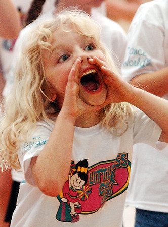 Globe/T. Rob Brown<br /> Ashley Koch, first grader, of Joplin, yells during the Little Miss Cheer Camp at Memorial Middle School in Joplin Monday evening, June 5, 2006.
