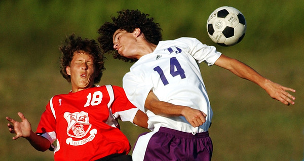 Globe/T. Rob Brown<br /> Carl Junction's Nathan Wilson and Thomas Jefferson's Cragin Currence use their heads to compete for control of the ball during Tuesday afternoon's game at Thomas Jefferson, Oct. 3, 2006. The game, tied 1-1 at the end of regular time, went into sudden victory overtime.