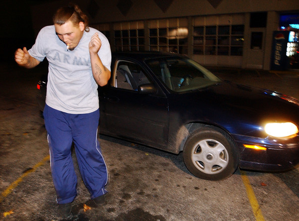 "Globe/T. Rob Brown<br /> Billy Barber of Joplin does a ""seawalk"" dance next to his car as people whistle and hollar at him on Main Street Joplin Friday night, Oct. 27, 2006.<br /> Section: News"