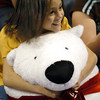 Globe/T. Rob Brown<br /> Boys & Girls Club member Anna Revels, 9, of Joplin, hugs a large stuffed Coca-Cola polar bear after winning it in a drawing during the club's annual Christmas party Thursday night, Dec. 14, 2006.<br /> Section: COMMUNITY SHOT