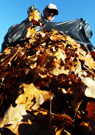 Globe/T. Rob Brown<br /> Jeremiah Doug Eubanks, Joplin Public Works employee, adds another bag of leaves to the compost pile at the Turkey Creek Waste Water Treatment Plant Friday afternoon, Nov. 17, 2006.<br /> Section: News