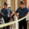 Globe/T. Rob Brown<br /> Joplin Police Chief Kevin Lindsey speaks to two Missouri State Highway Patrol troopers and other personnel across the street from Memorial Middle School Monday morning, Oct. 9, 2006, following a shooting at the school. They were awaiting the arrival of Gov. Matt Blunt.<br /> Secton: News