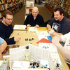"Globe/T. Rob Brown<br /> Roleplayers, pictured from left, Phillip Hilt of Joplin playing a gnome bard, John Manard of Joplin playing a human cleric, Jonathan Gruver of Arma, Kan., playing a shifter barbarian, Jim ""Nimrod"" Stokes of Chetopa, Kan., playing a changeling rogue and Jesse White of Joplin playing a human marshall share a laugh as their characters face down a battalion of glass skeleton dwarves in the Eberron campaign setting for Dungeons & Dragons during the Quarterly Game Day at Changing Hands Book Shoppe on Virginia Street in Joplin Saturday afternoon, Feb. 4, 2006.<br /> Section: T&C WED Story: Derek"