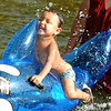Globe/T. Rob Brown<br /> Angie Gaytan (right) assists Abel Parra, 2, both of Southwest City, as he gets splashed by someone else on a killer whale floatie at the Cowskin Access on the Elk River, near Tiff City, Saturday afternoon, July 29, 2006.<br /> Section: News