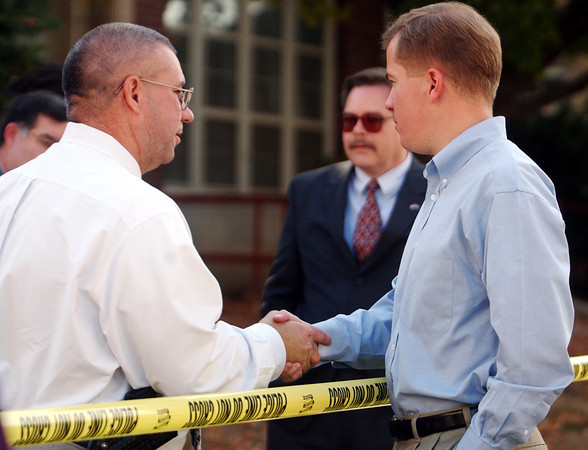 Globe/T. Rob Brown<br /> Gov. Matt Blunt (right) shakes hands with Joplin Police Chief Kevin Lindsey before crossing the police line onto Memorial Middle School's property Monday afternoon, Oct. 9, 2006, following a shooting at the school.<br /> Secton: News