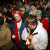 Globe/T. Rob Brown<br /> A large crowd gathers, including Niki Holbrook of Noel (right), Shelly Smith (center) and Bertha Contreras (left), both of Anderson, as they hold candles during a candlelight vigil outside the remains of the group home fire in Anderson Monday night, Dec. 4, 2006.<br /> Section: News