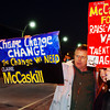 Globe/T. Rob Brown<br /> Supporters of Claire McCaskill for senator, Max Gipson and Grace Gipson, both of Carthage, hold up signs as they wait for McCaskill to arrive at the Jasper County Democrats headquarters on Main Street in Joplin Wednesday night, Nov. 1, 2006.<br /> Section: News