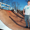 Globe/T. Rob Brown<br /> Jud Heald of Duquesne holds his skateboard while standing on some ramps in his backyard Thursday afternoon, Dec. 29, 2005. Heald is a professional skateboarder with an international Christian ministry called Untitled. He is also involved with The Bridge in Joplin.<br /> Section: People Story: Chadwick Watters