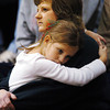 Globe/T. Rob Brown<br /> An under-the-weather Zoey Russell, 6, of Joplin, rests on the shoulder of family friend Missy Taylor of Joplin during the Joplin High School girls basketball game against Bentonville Tuesday evening, Dec. 19, 2006.<br /> Section: News