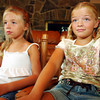 Globe Photo Illustration/T. Rob Brown<br /> Neither Brooke Montgomery, 8, (right) nor her sister Bethany Montgomery, 6, seem to like the military news they're seeing on CNN Tuesday evening, July 11, 2006, in the Montgomery home in Oronogo.<br /> Section: Health & Family