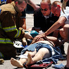 Globe/T. Rob Brown<br /> Emergency personnel work to save the life of a person following a motorycle and vehicle collision at the intersection of 7th and Florida streets Friday afternoon, June 9, 2006.<br /> Section: News