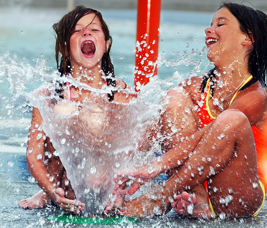 Globe/T. Rob Brown<br /> Alexis Lakin, 9, of Iola, (left) and friend Chantal Caltron, 10, of Joplin, show their excitement as a water fountain sprays them Thursday evening, June 1, 2006, in the pool area at Cunningham Park in Joplin.<br /> Section: News COMMUNITY SHOT?