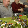 "Globe/T. Rob Brown<br /> Mike Selsor of Carthage, left, and John Davidson, Changing Hands Book Shoppe owner, watch and discuss a turn of the game ""Eagles to Glory,"" a historical miniatures wargame. In this scenario they are in the Battle of Trebbia from the Napoleonic Wars in Northern Italy in 1799 during the Quarterly Game Day at Changing Hands Book Shoppe on Virginia Street in Joplin, Saturday afternoon, Feb. 4, 2006.<br /> Section: T&C WED Story: Derek"