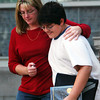 Globe/T. Rob Brown<br /> Bobbie Pottorff holds onto her son Jordan, 11, as they walk down the front steps from Memorial Middle School Monday morning, Oct. 9, 2006, following an incident involving an armed student.<br /> Section: PEOPLE