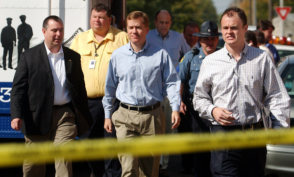 Globe/T. Rob Brown<br /> Gov. Matt Blunt and entourage walk toward the crowd just outside Memorial Hall near Memorial Middle School Monday morning, Oct. 9, 2006, following a shooting at the school.<br /> Secton: News