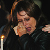 Globe/T. Rob Brown<br /> Becky Moyer tries to dry her tears as she is comforted by Tiffany Coleman, both of Quapaw, Okla., as they hold candles during a candlelight vigil outside the remains of the group home fire in Anderson Monday night, Dec. 4, 2006.<br /> Section: News