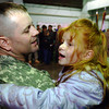 Globe/T. Rob Brown<br /> Jesse Vogel of Joplin and the 414th Military Police Company, holds his daughter Liberty Vogel, 5, during a reception for the company's arrival back from Iraq, at the U.S. Army Reserve Center in Joplin, Mo.<br /> Section: News