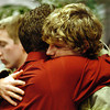 Globe/T. Rob Brown<br /> Matt Smallwood, right, of Carthage, brother of the deceased, gets a hug from a Sigma Chi fraternity brother from Pittsburg State University during a gathering at Fairview Christian Church in Carthage to remember Smallwood's sister Monday night, Dec. 11, 2006.<br /> Section: News