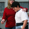 Globe/T. Rob Brown<br /> Bobbie Pottorff holds onto her son Jordan, 11, as they walk down the front steps from Memorial Middle School Monday morning, Oct. 9, 2006, following an incident involving an armed student.<br /> Section: News